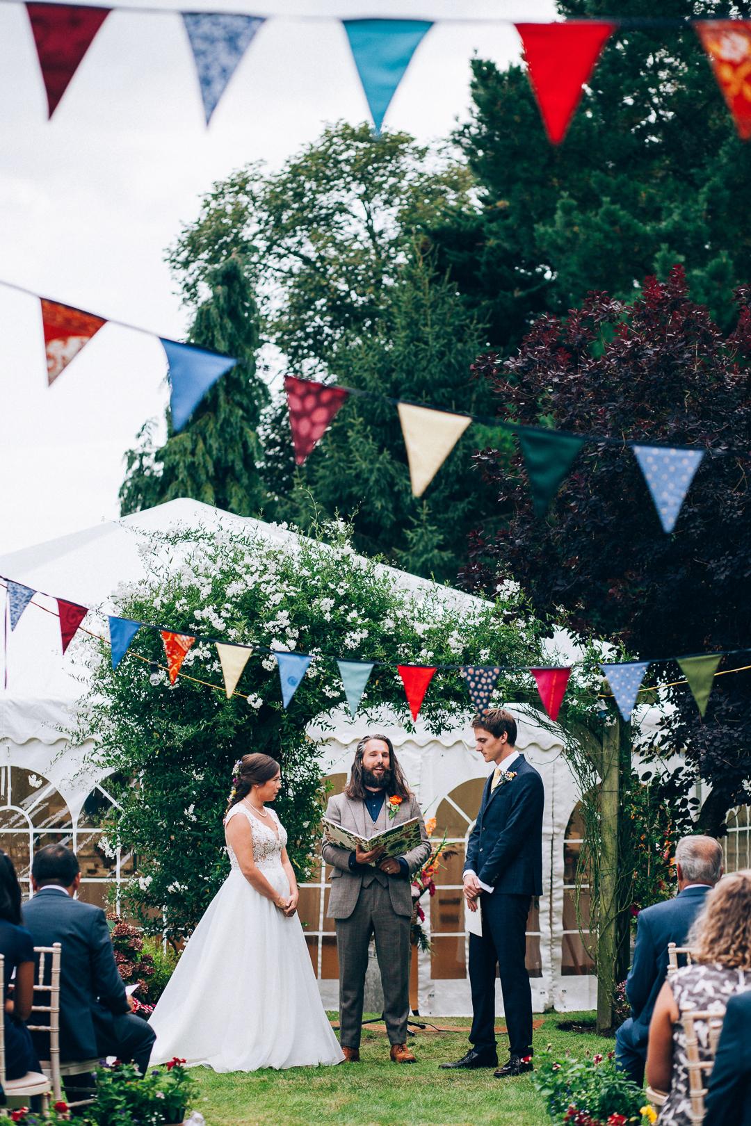 Devon colourful garden wedding humanist ceremony under the trees image