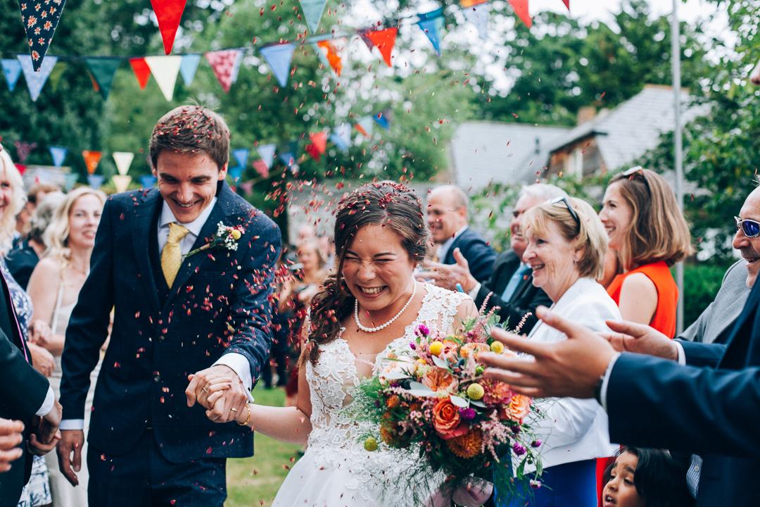 Devon colourful garden wedding humanist ceremony confetti image