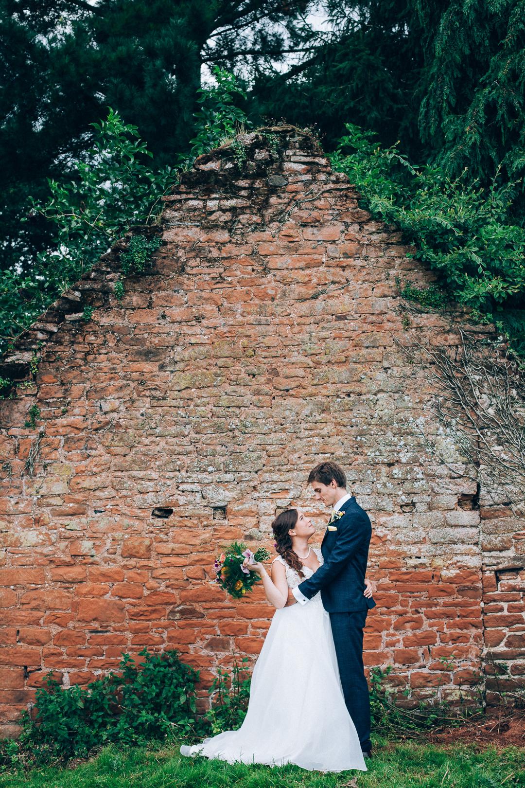 Devon colourful garden wedding humanist ceremony bride & groom portrait image