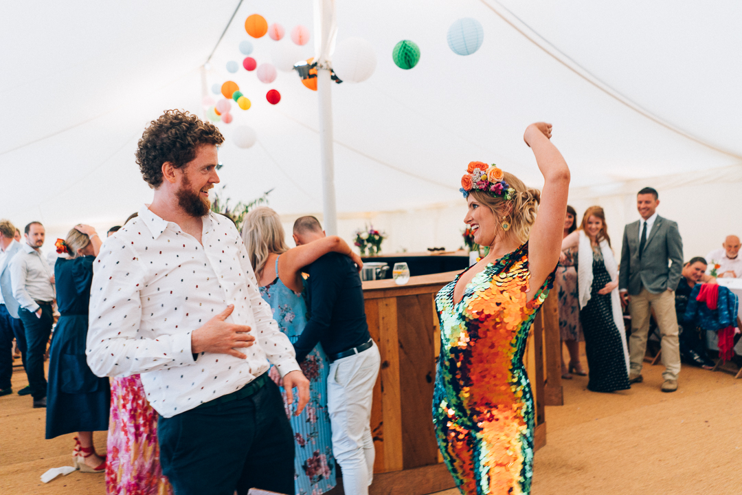 Bride dancing in sequin rosa bloom jumpsuit image