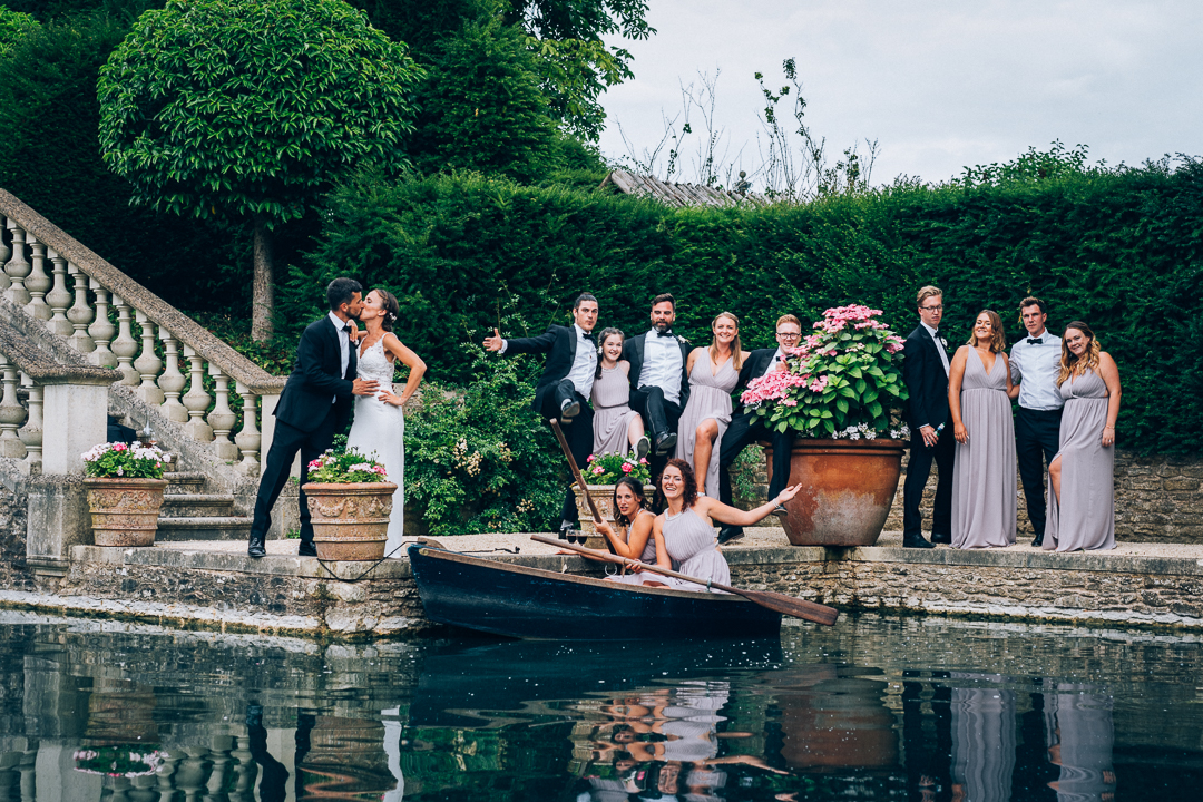 Wedding Party group photo by the boathouse at the lost orangery image