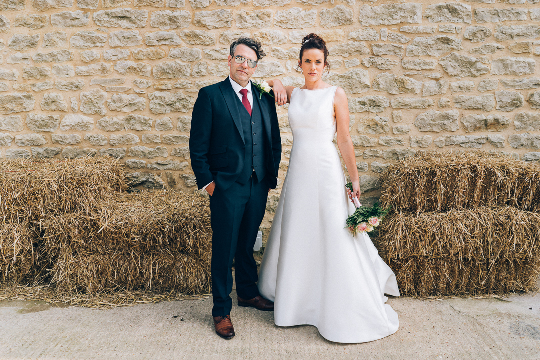 huntsmill farm bride and groom by hay bales image