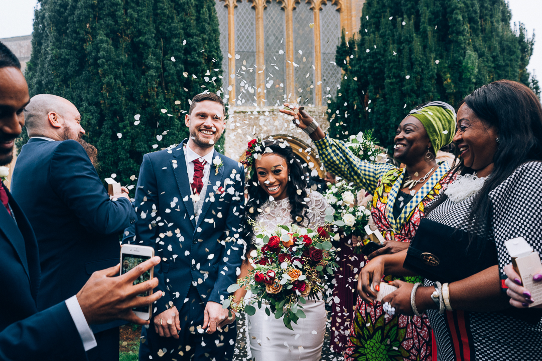 Confetti shot with bride and groom outside Martock All Saints Church