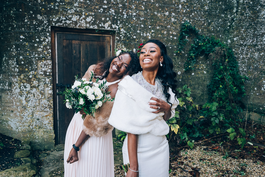 bride and bridesmaid smiling and fun photo at Brympton House Somerset wedding image