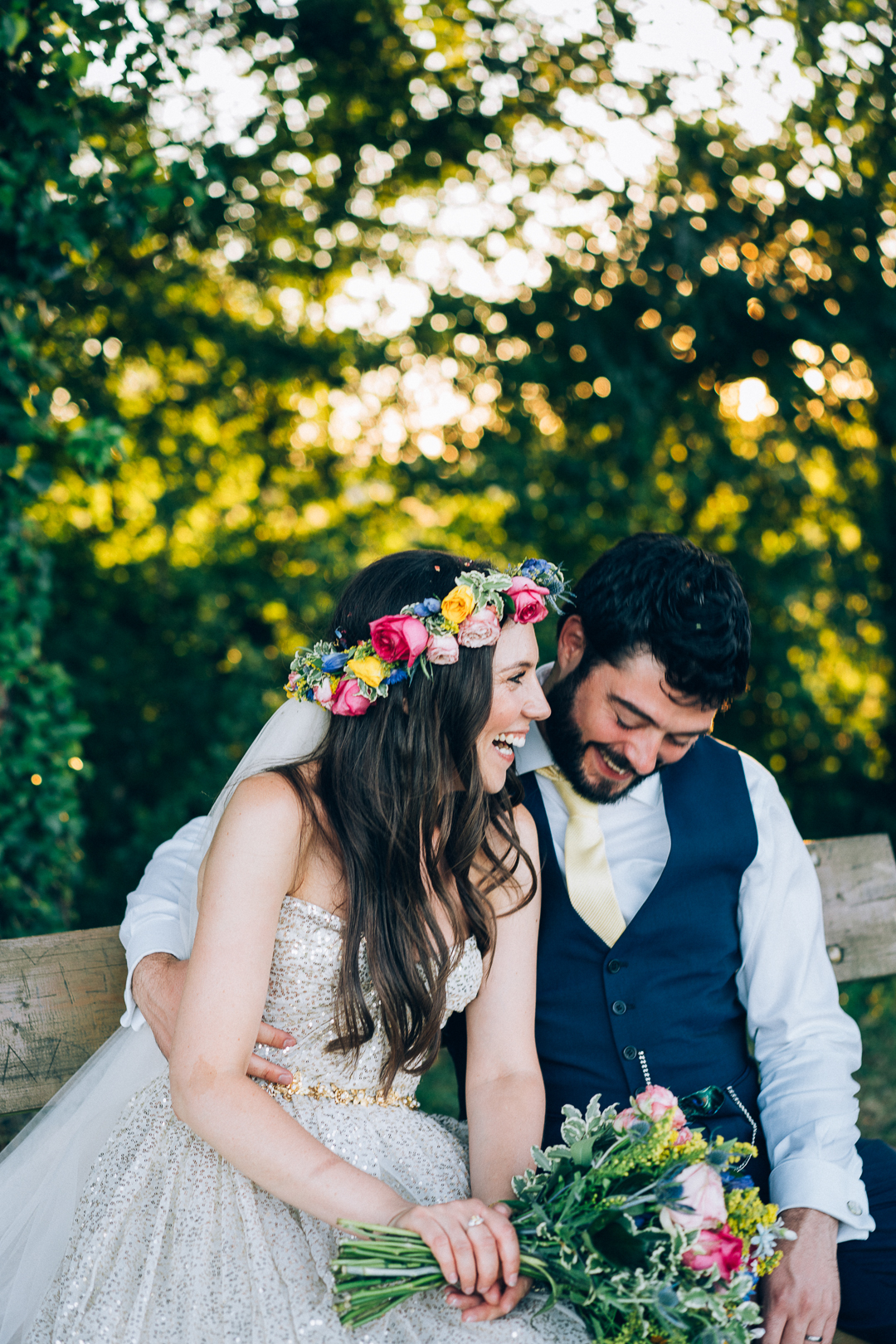 Golden hour bride and groom portrait smiling and laughing boho bride in gold dress and flower crown