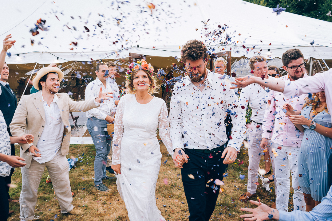 bride and groom through confetti back garden wedding festival bride image