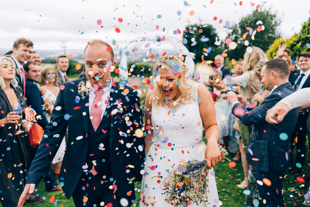 Somerset back garden wedding confetti with bride and groom image