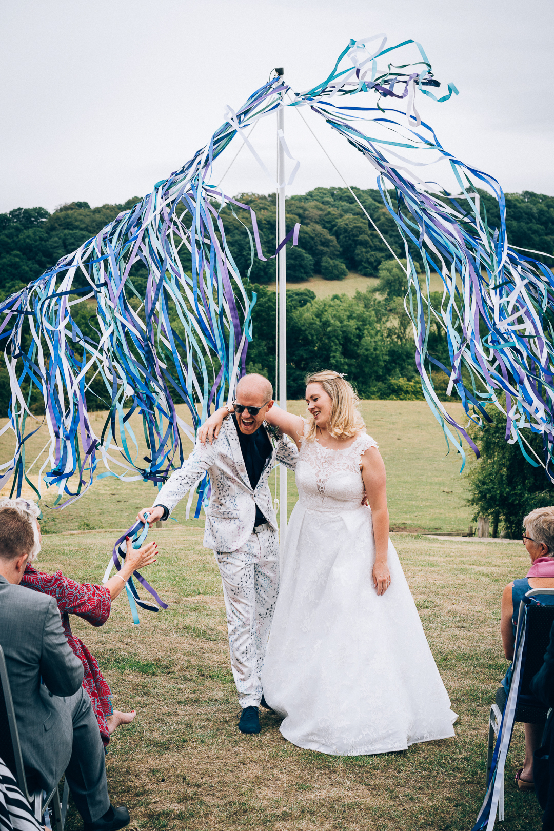 Wilderhope Manor Humanist Wedding outside with ribbons