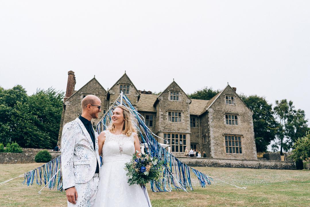 bride and groom outside wilderhope manor