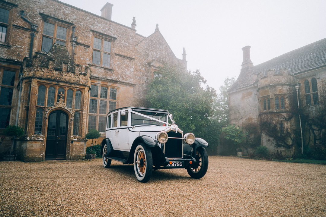 image of Brympton House in December with wedding car out the front