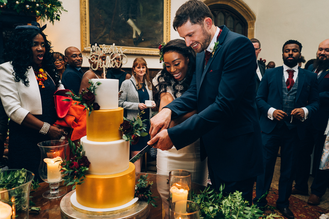 image of bride and groom cutting their wedding cake by Little Buttercup Bakery at Brympton House