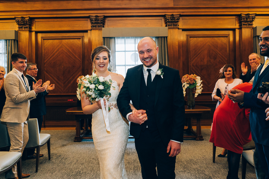 image of bride and goom just married leaving ceremony room at Old Marylebone Town Hall