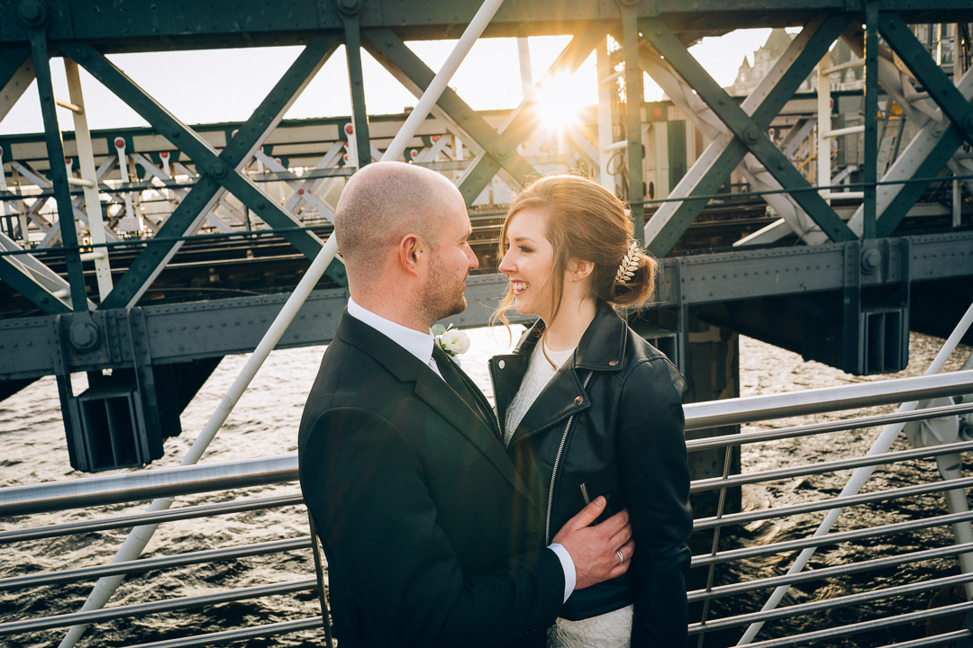 image golden hour portrait of old marylebone town hall bride and groom london wedding