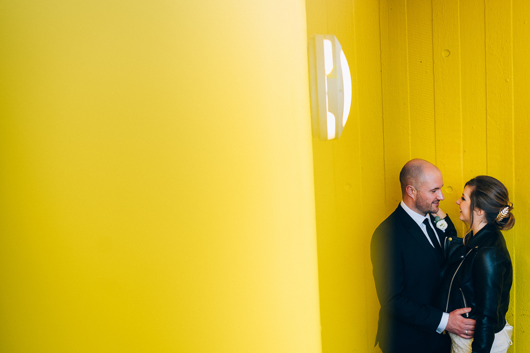 image of old marylebone town hall wedding couple urban yellow background