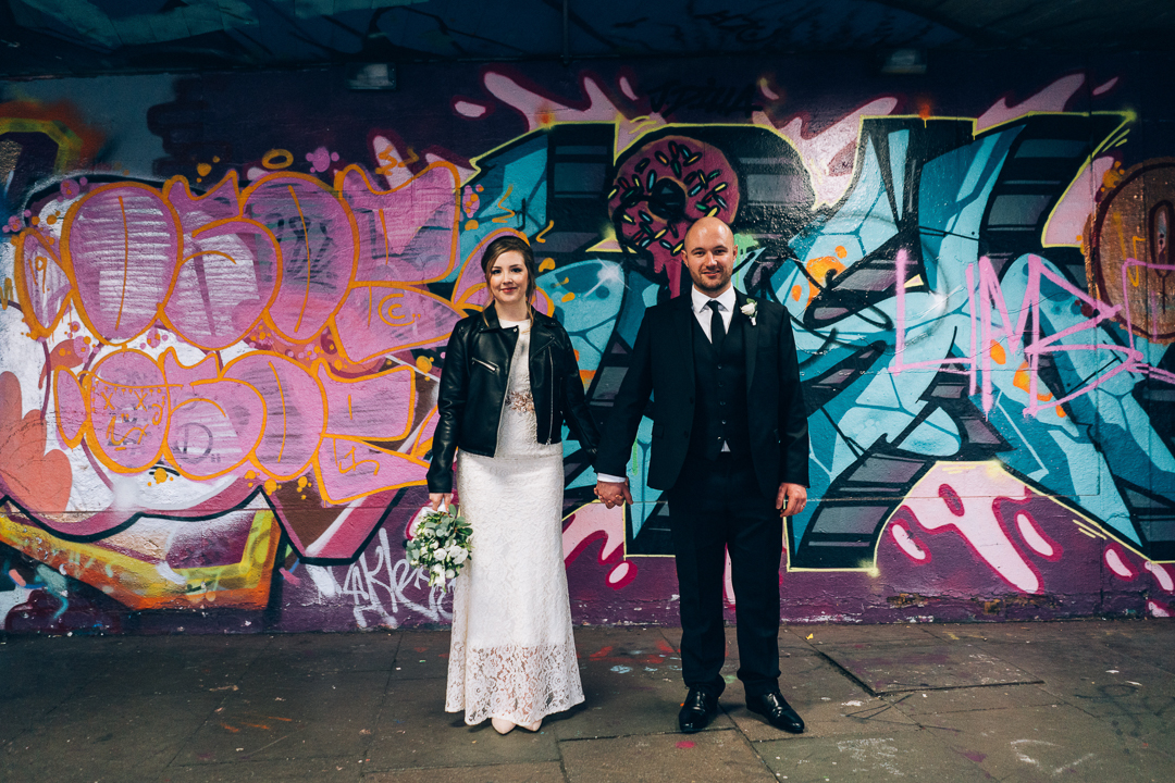 image of old marylebone town hall wedding couple on south bank by graffiti