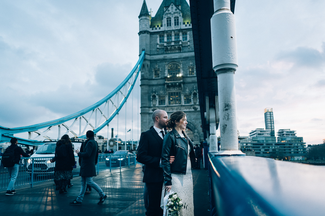 image of old marylebone town hall wedding couple on tower bridge london