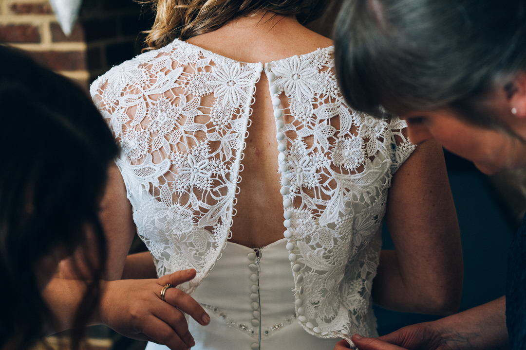 image of the back of brides dress at the corn barn cullompton wedding