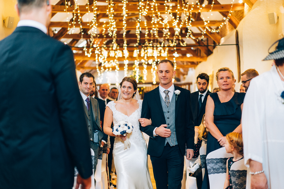 image of the bride walking up the aisle at The Corn Barn Cullompton