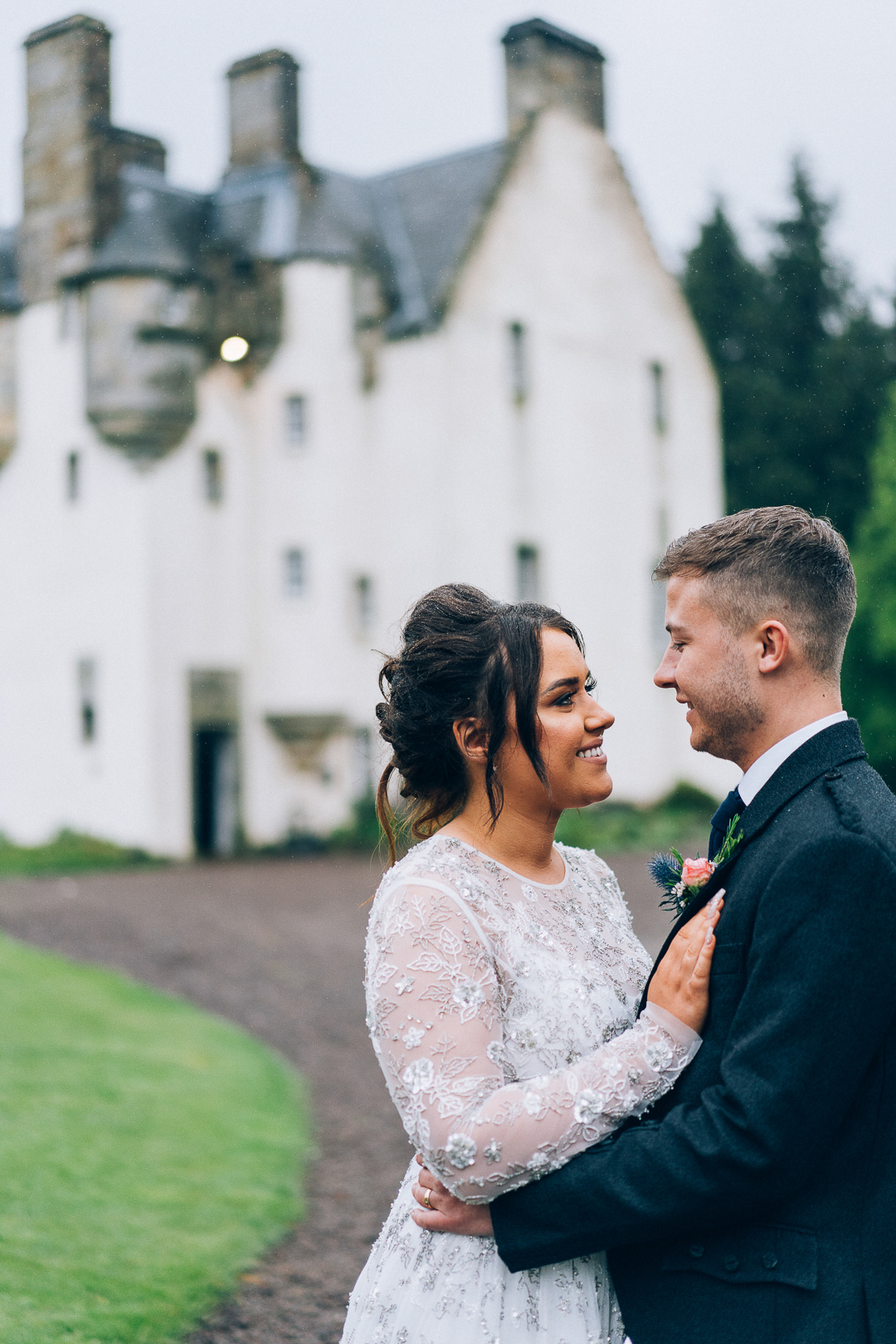 image of bride and groom outside Tullibole Castle